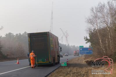 Vrachtwagen brand A28 't Harde Li 73,5 door vastgelopen remmen. - ©NWVFoto.nl