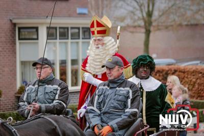Sinterklaas met pietenband op bezoek in Doornspijk. - ©NWVFoto.nl