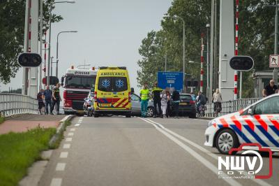Lange file op de Flevoweg N309 door ongeval op de brug naar Flevoland, en festival gangers op weg naar LowLands . - ©NWVFoto.nl