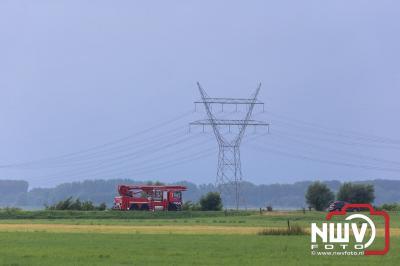 Vier 125 KV masten omvergeblazen tijdens natuurgeweld polder Oosterwolde (gld) - © NWVFoto.nl