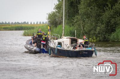 Uitgebreid onderzoek na het aantreffen van een overleden persoon in zeilbootje haven van Elburg. - © NWVFoto.nl